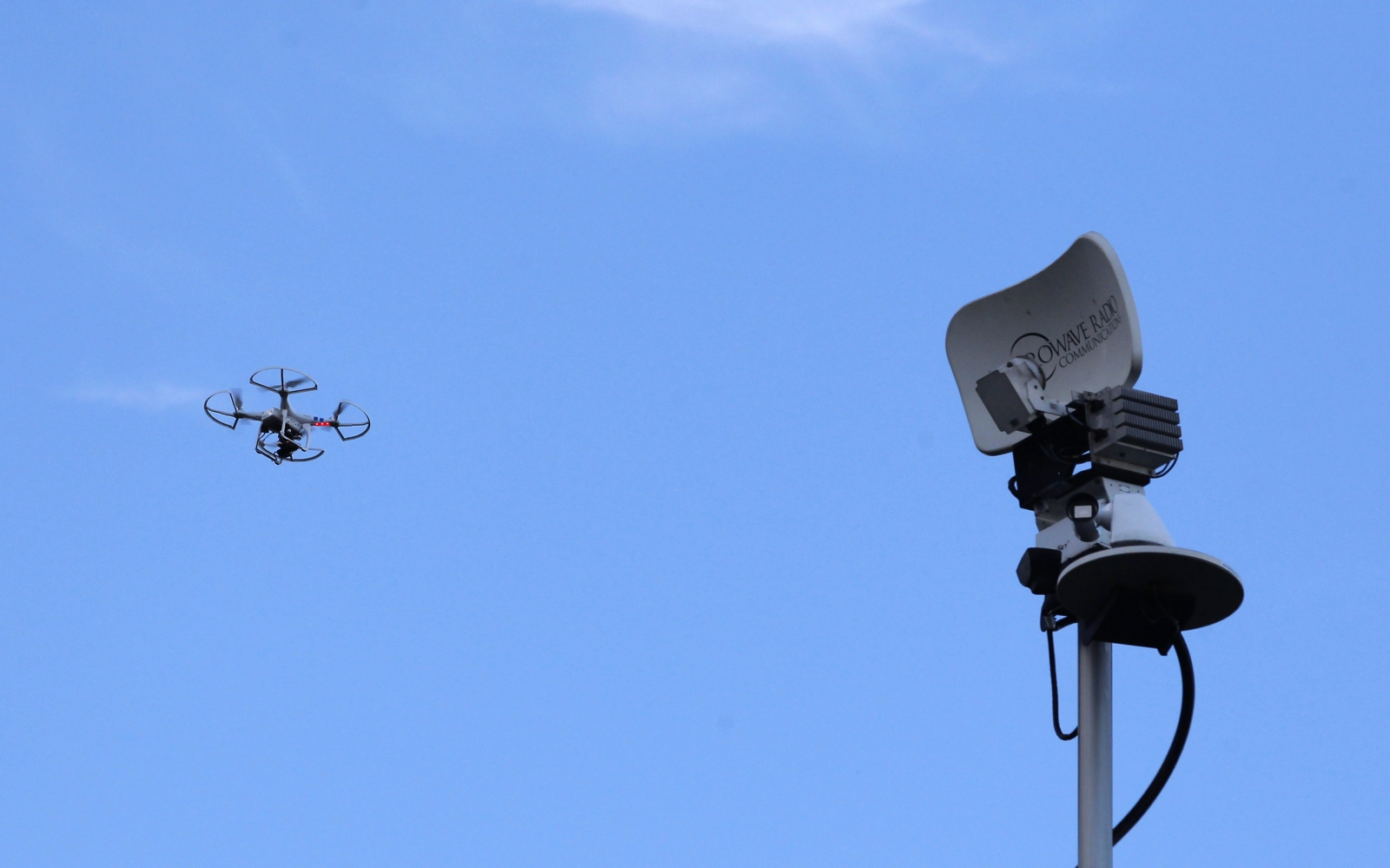 A drone flying near a residential TV antenna