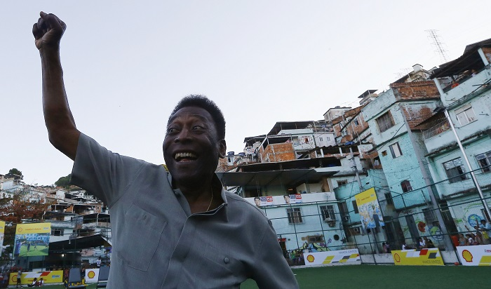 Football legend Pele poses for media at the inauguration of the refurbished energy-saving football pitch at the Morro da Mineira favela in Rio de Janeiro, Brazil.