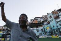 Football legend Pele poses for media at the inauguration of the refurbished energy-saving football pitch at the Morro da Mineira favela in Rio de Janeiro, Brazil.