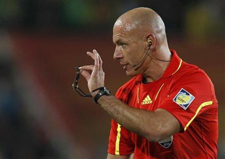 Referee Webb holds up his whistle during the 2010 World Cup second round soccer match between Brazil and Chile at Ellis Park stadium in Johannesburg