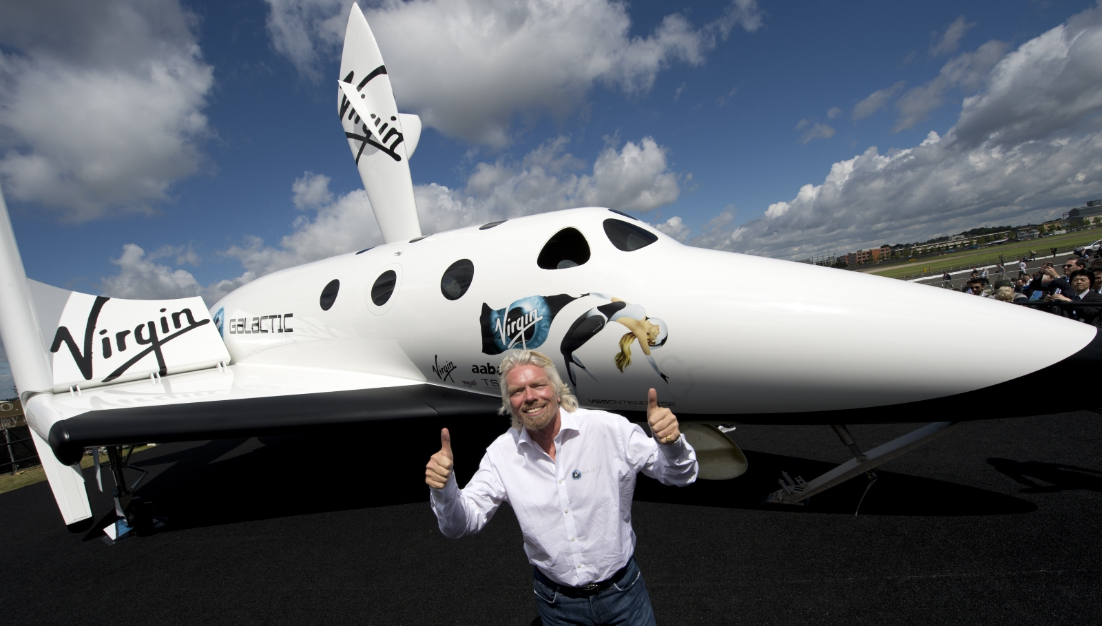 Branson in front of a model of the Virgin Galactic craft. (Getty)