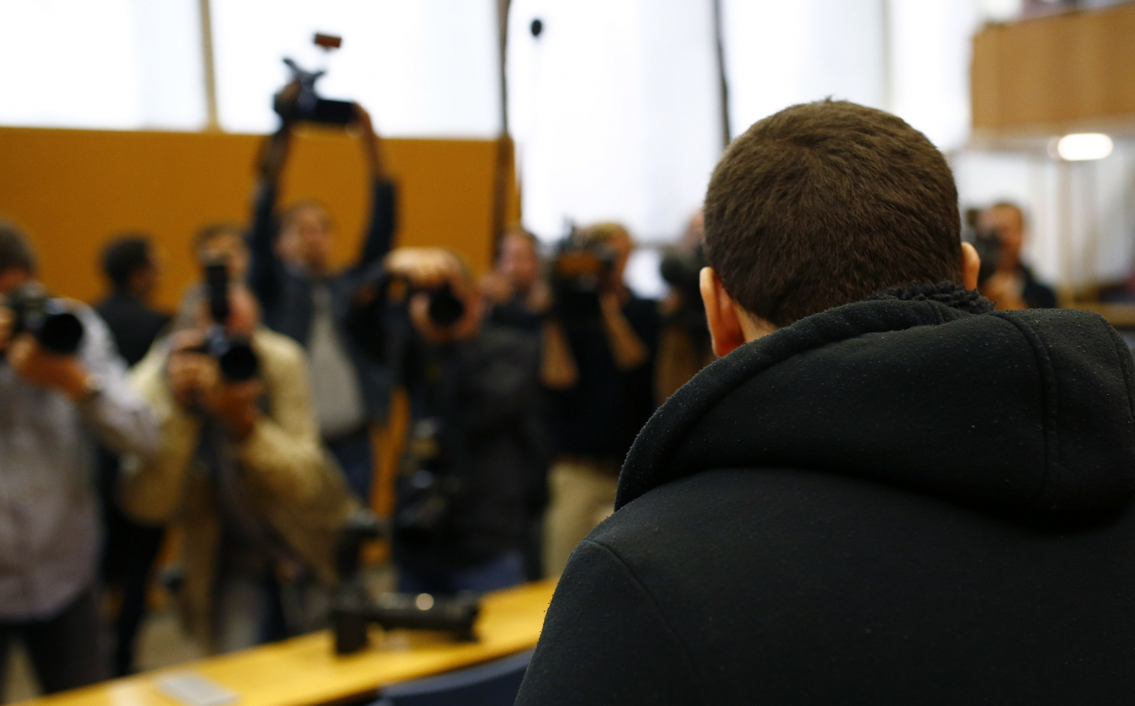 Defendant Kreshnik B., waits for the start of his trial in a courtroom in Frankfurt