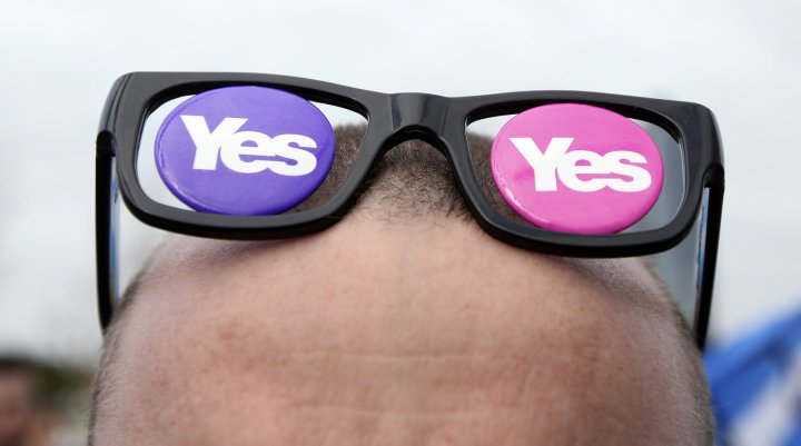 A 'Yes' supporter with 'Yes' spectacles is seen at a rally outside the BBC in Glasgow, Scotland September 14, 2014.