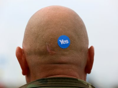 Yes sticker on bald mans head