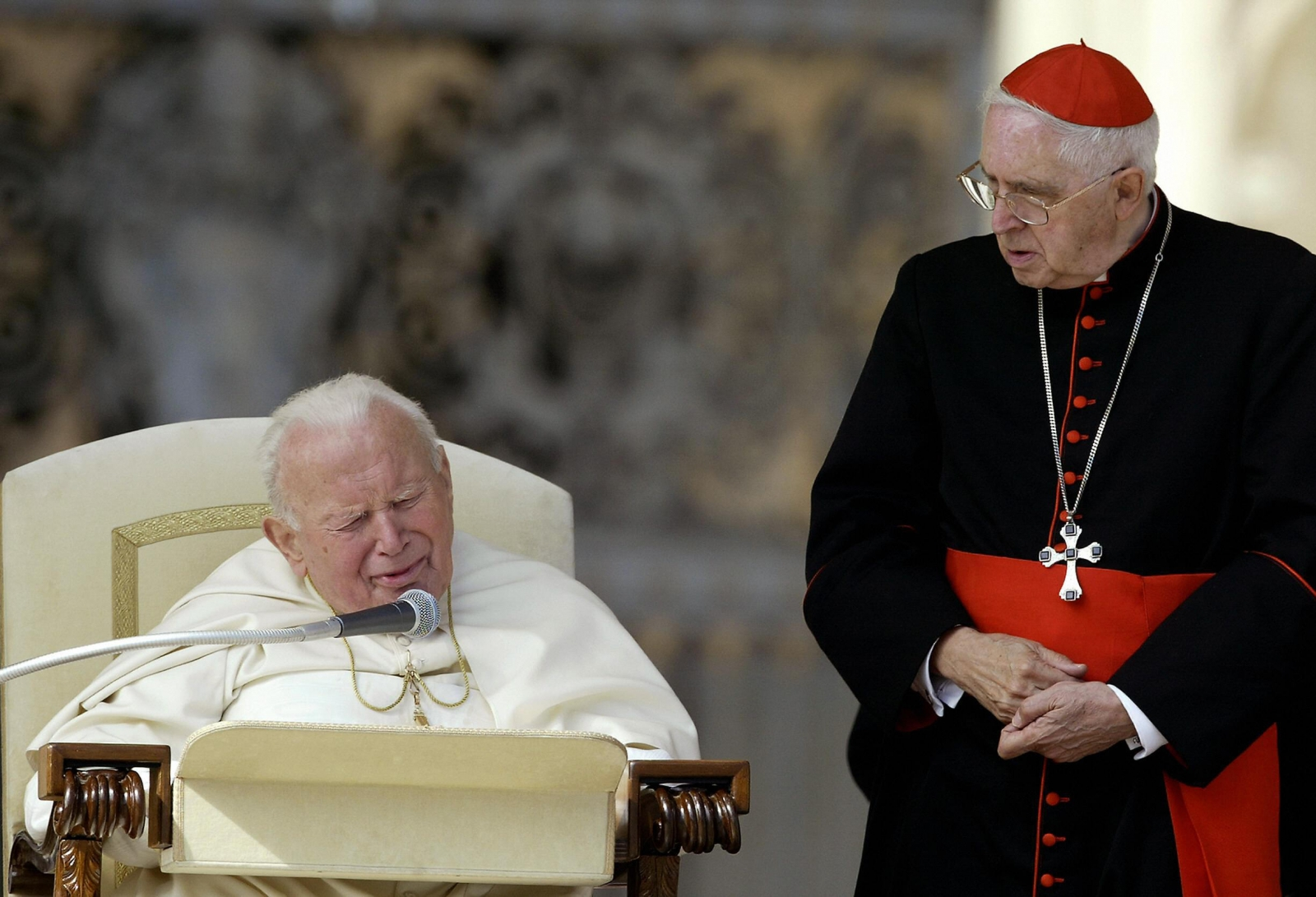 Argentinean Cardinal Jorge Maria Mejia (R) looks at Pope John Paul II during his weekly general audience in St Peter's square at the Vatican 08 October 2003