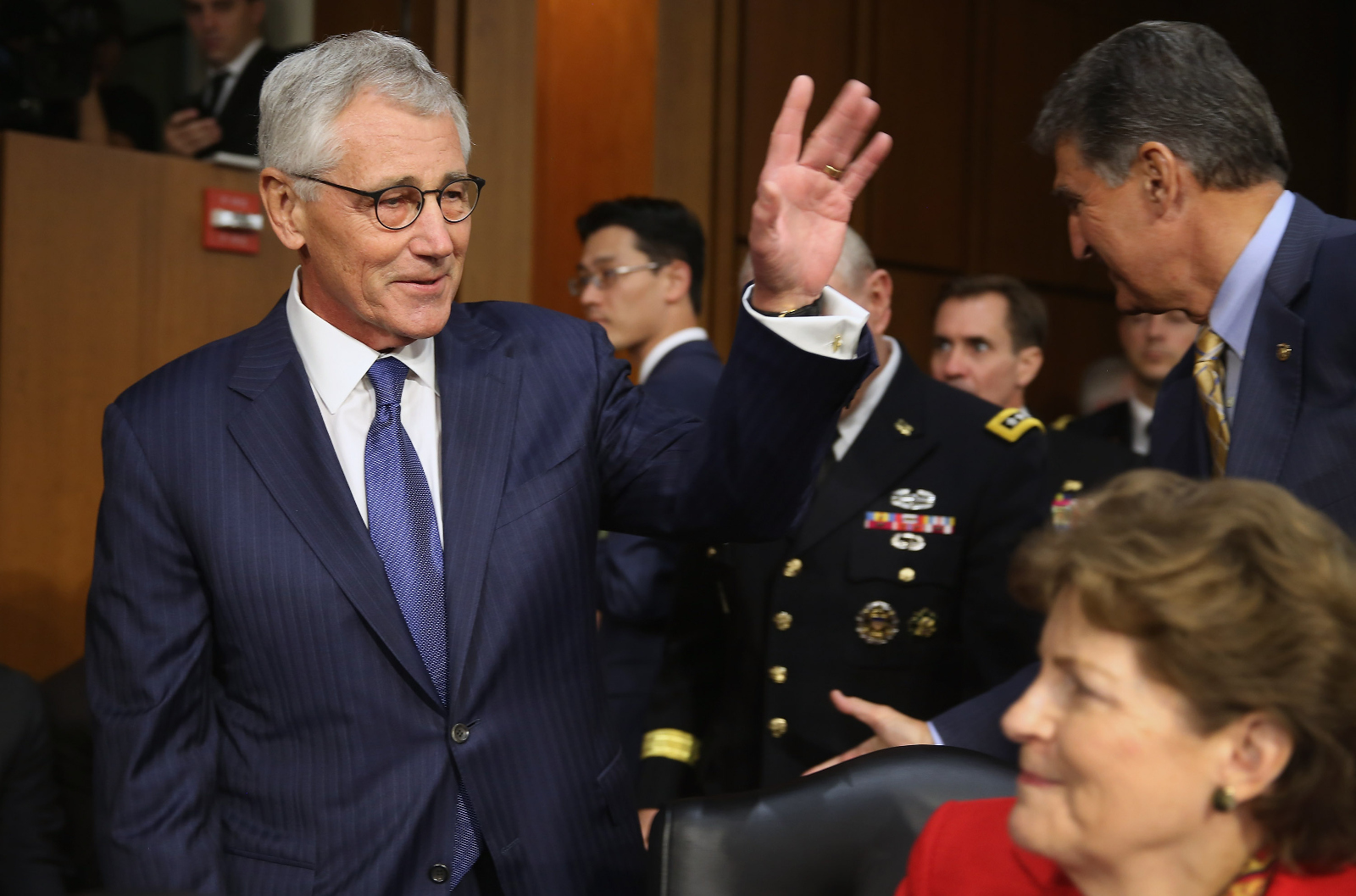 Chuck Hagel greets Senate Armed Services Committee