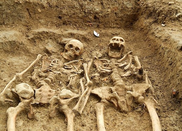 Ancient skeletons unearthed in Leicester with arms entwined after more than 700 years.