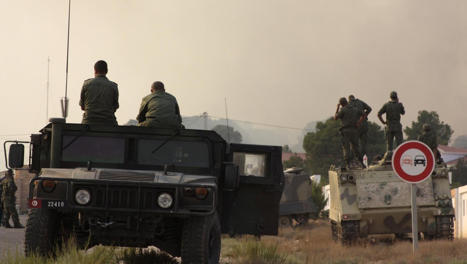 Tunisian soldiers gather near the border with Algeria around Mount Chaambi, western Tunisi