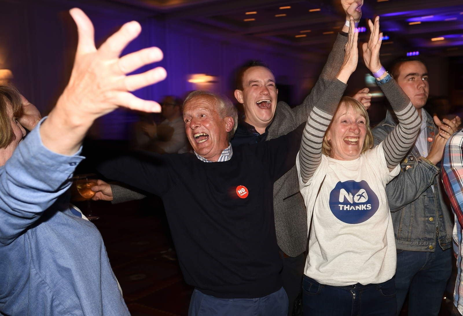 "Supporters from the ""No"" Campaign react to a declaration in their favour, at the Better Together Campaign headquarters in Glasgow, Scotland"
