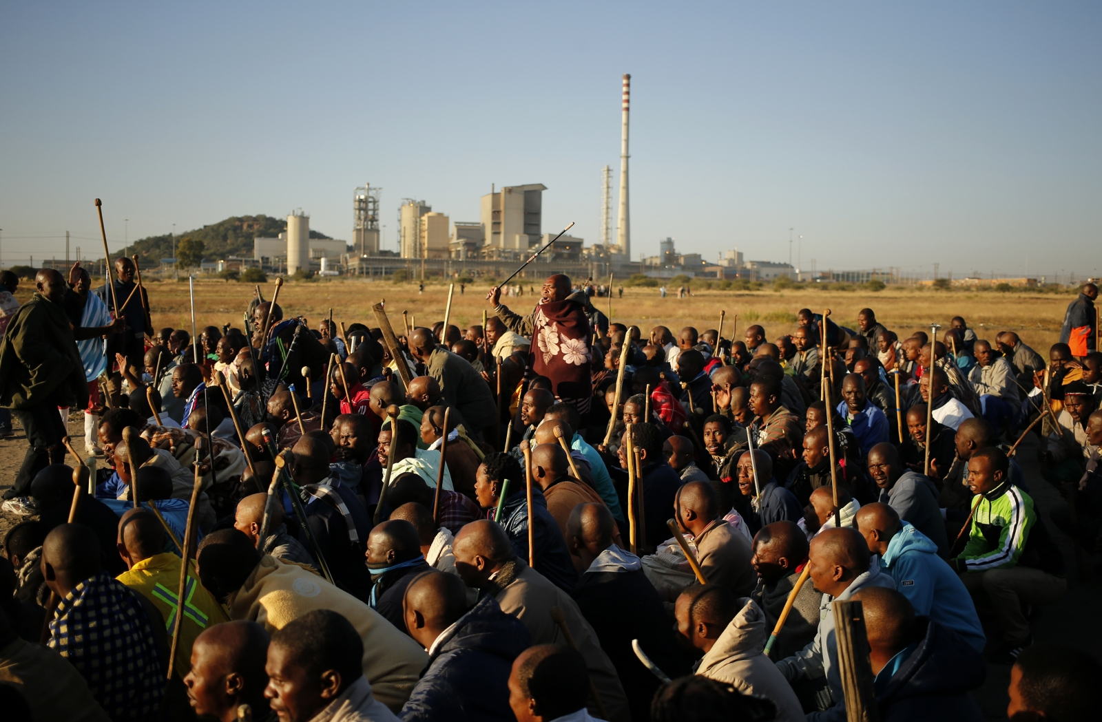 South African miners on strike chant slogans as they march in Nkaneng township outside the Lonmin mine in Rustenburg May 14, 2014