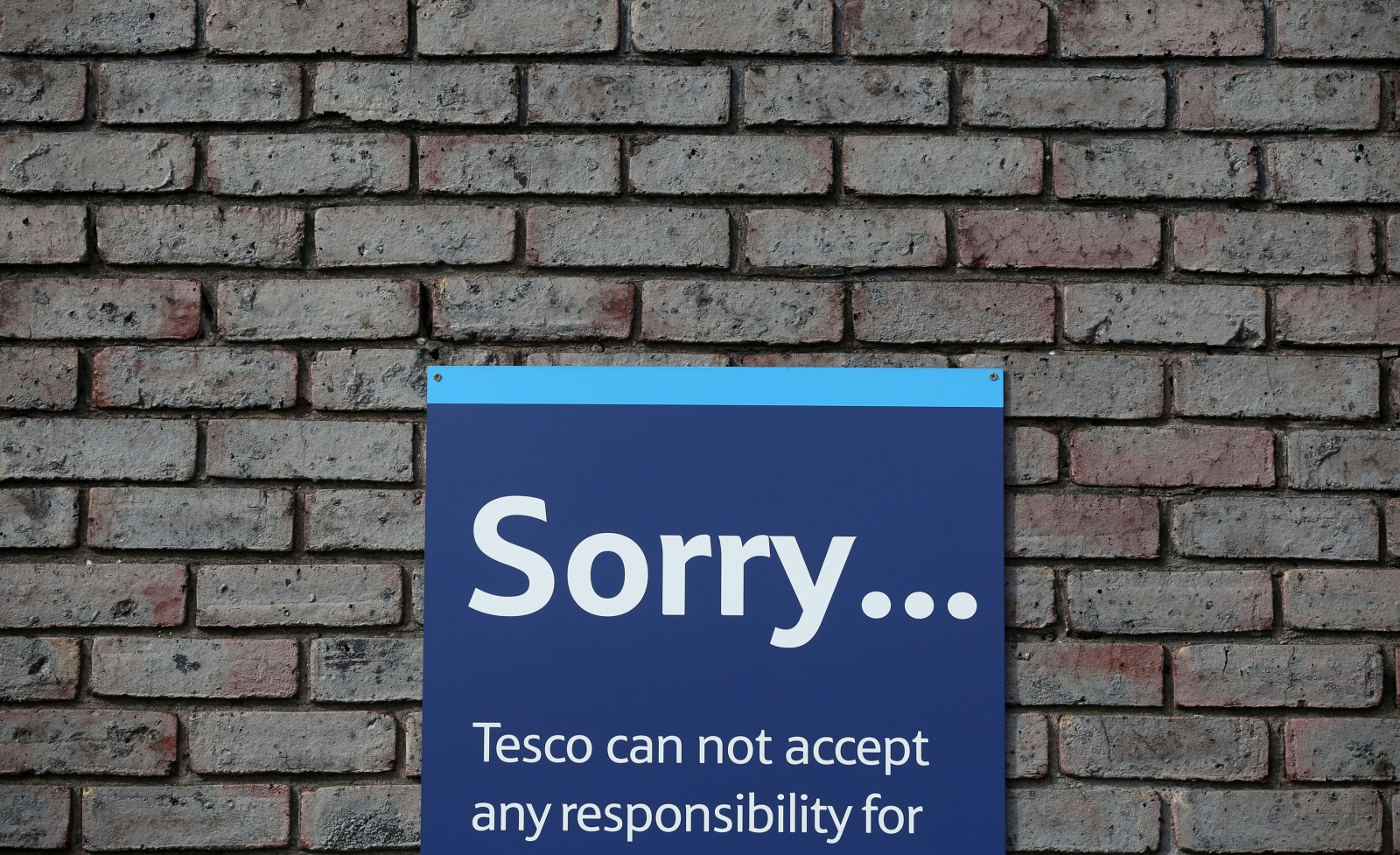 A sign is seen on the wall of a Tesco building in Bow, east London August 29, 2014.