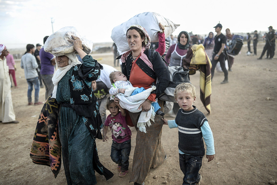 Fleeing isis tens of thousands of syrian kurds cross border into