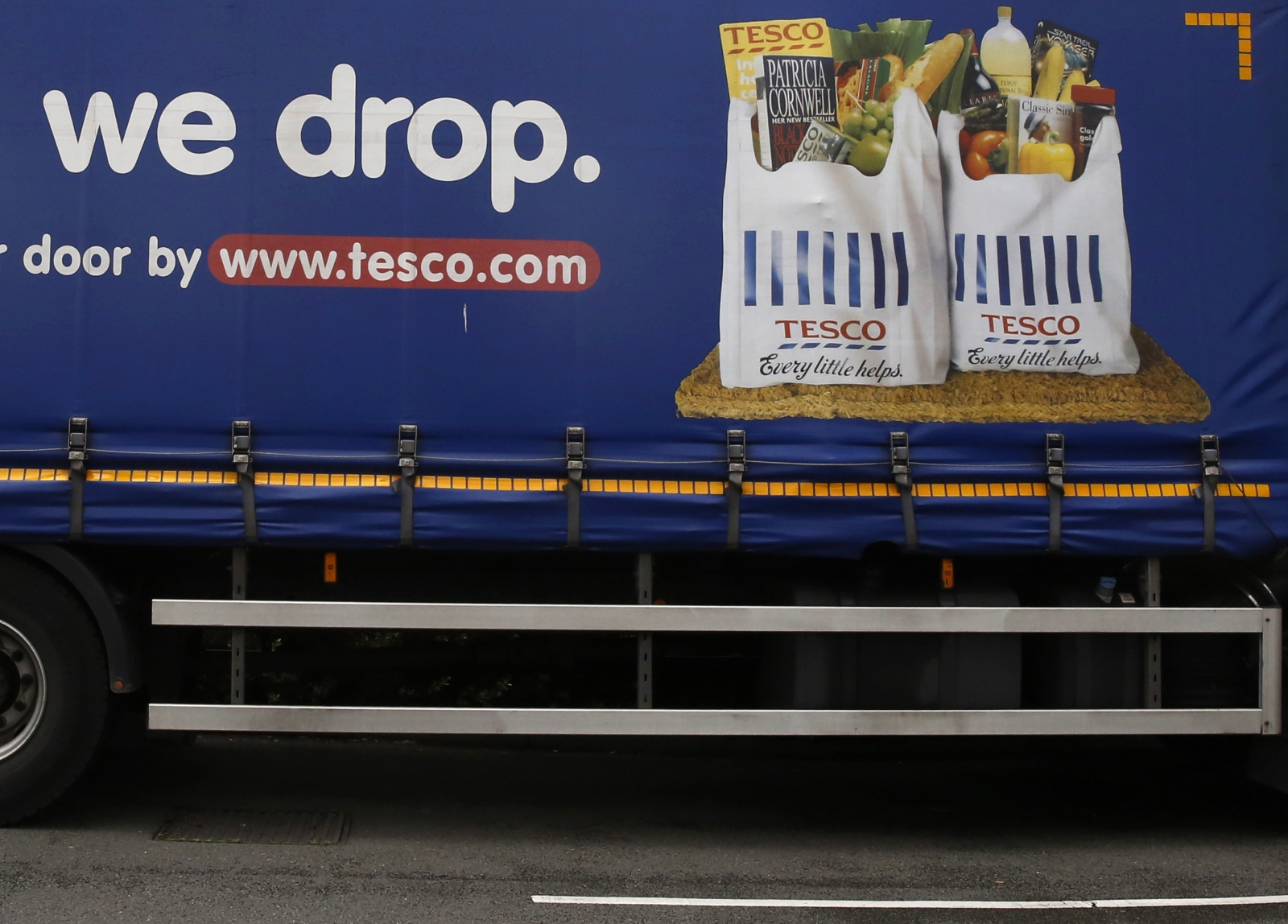 Part of a slogan is pictured on the side of a Tesco supermarket delivery truck in New Malden southwest London June 4, 2014.