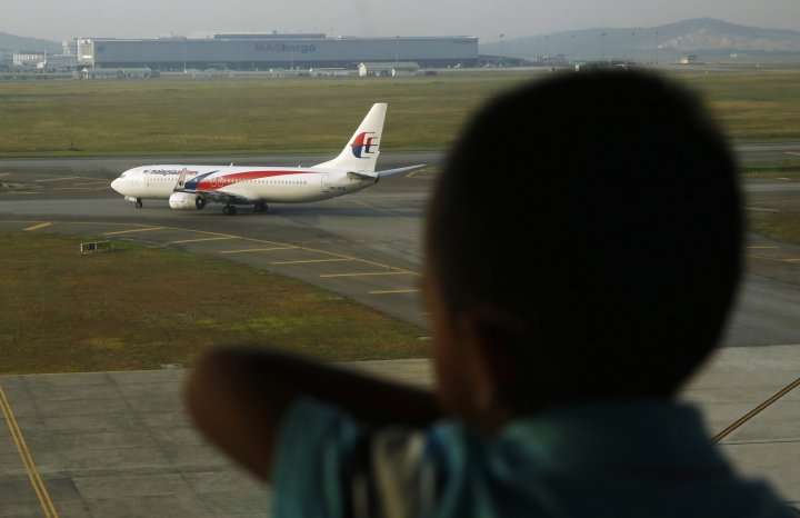 MH370 book author Ewan Wilson has defended his 'Truth' book from criticism by Malaysia Airlines