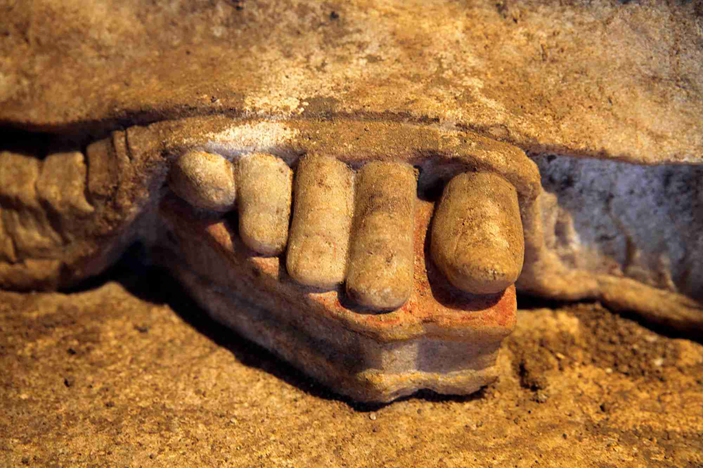 Close-up of the life-like toes of the ancient Greek caryatid statue