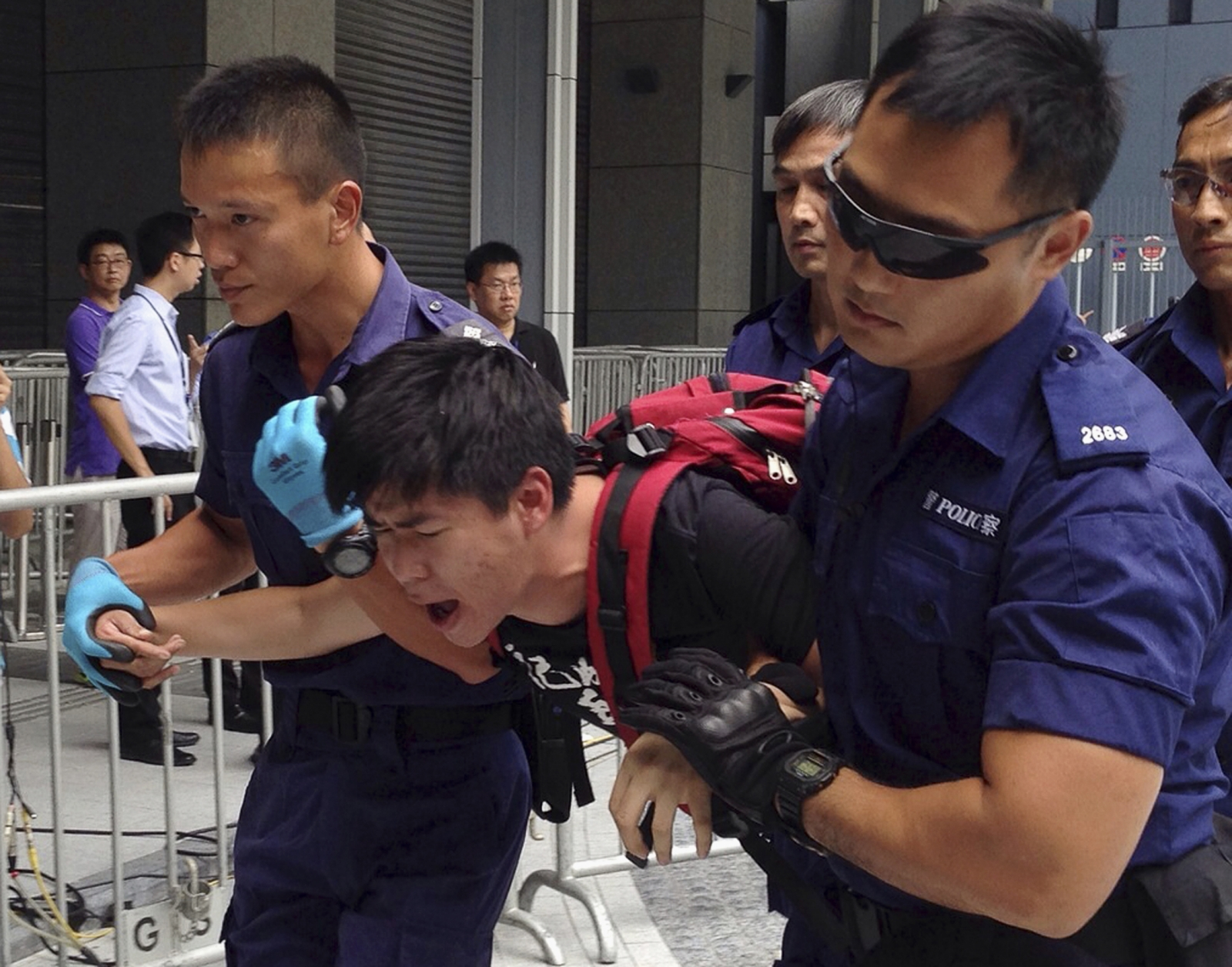 Hong Kong riot police used pepper spray to disperse protesters around government headquarters