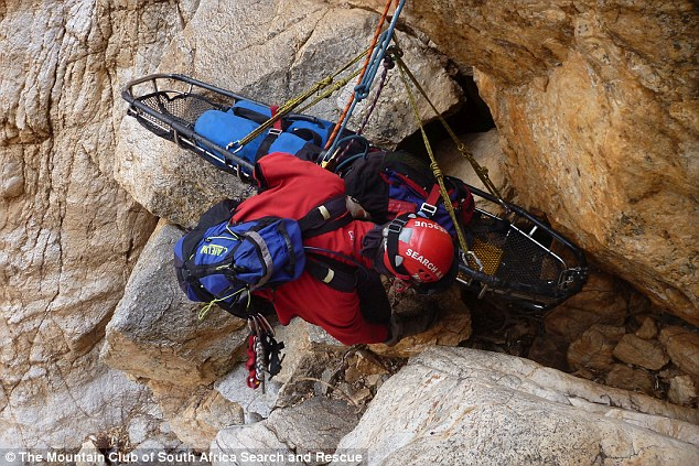 A rescue worker lowers a stretcher to help Tsenolo Shadrack Rasello, whose leg had be amputated after becoming trapped climbing. (Mountain Club of South Africa Search and Rescue)