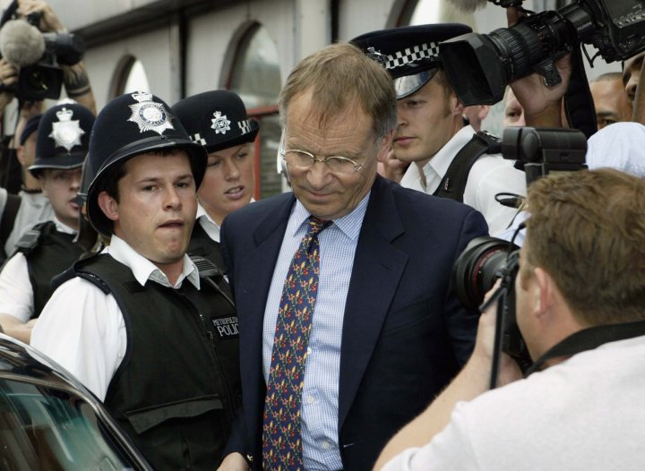 Lord Archer visits his probation officer in 2003 (Getty)