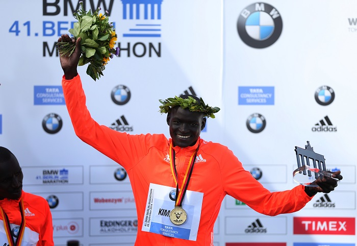 Dennis Kimetto of Kenya holds up his trophy as he celebrates during the awards ceremony for the 41st Berlin marathon