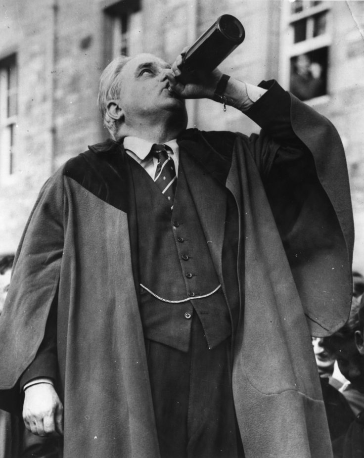 Robert Boothby downs a bottle of ale, as part of the traditional ceremony as he is made Rector of Aberdeen University in 1959 (Getty)
