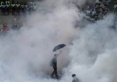 Hong Kong Occupy Central protestor in tear gas