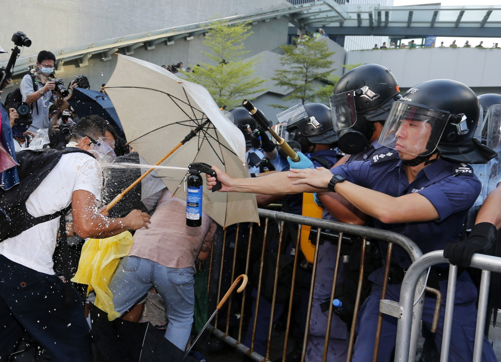 Hong Kong Occupy Central - police using pepper spray on protestors
