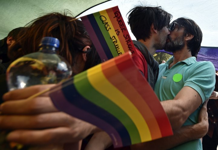 A couple kiss at Pride Belgrade, 2014.