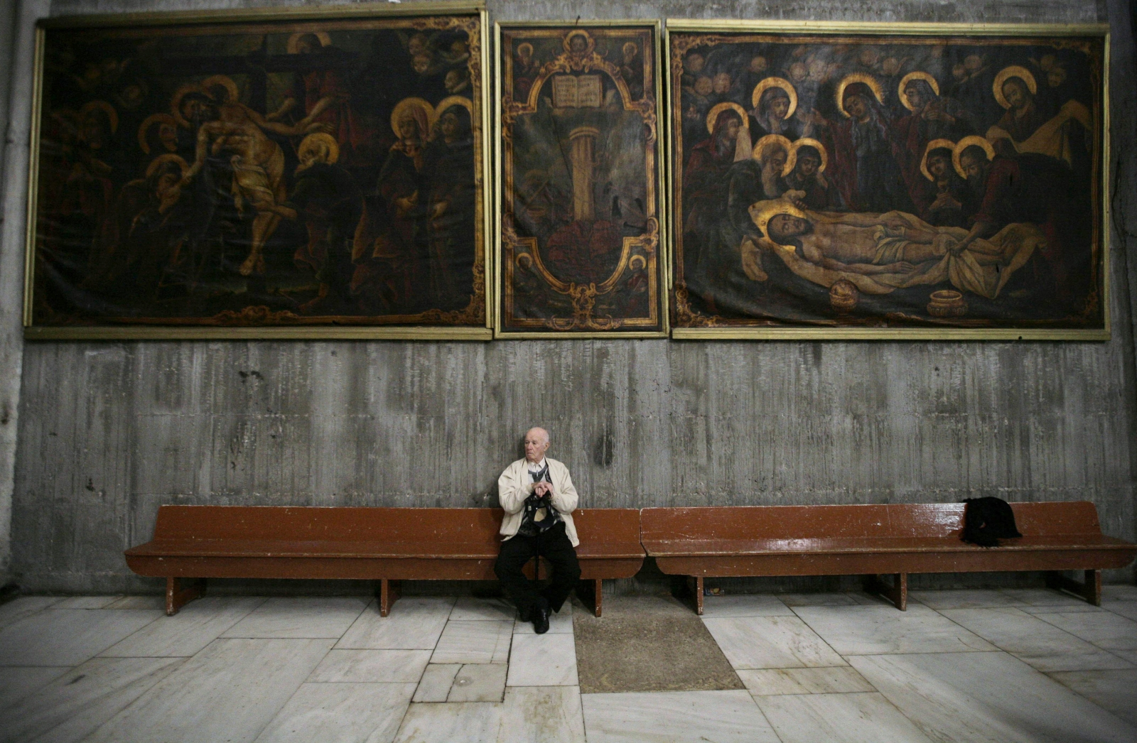 A tourist rests during a visit at the Church of the Holy Sepulchre in Jerusalem's Old City
