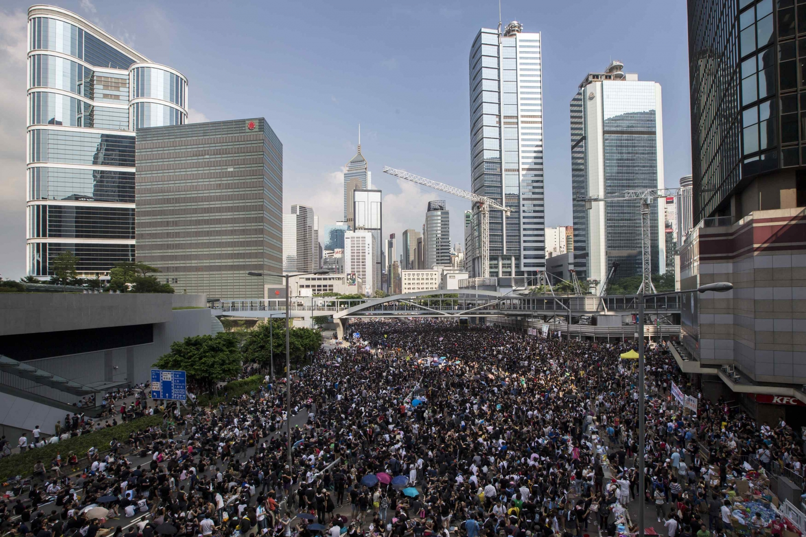 Thousands of Protesters Block Hong Kong Roads after Night of Violence