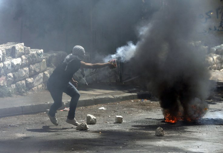 A Palestinian prepares to throw fire crackers during clashes with Israeli police in the East Jerusalem neighbourhood of Wadi al-Joz September 8, 2014.