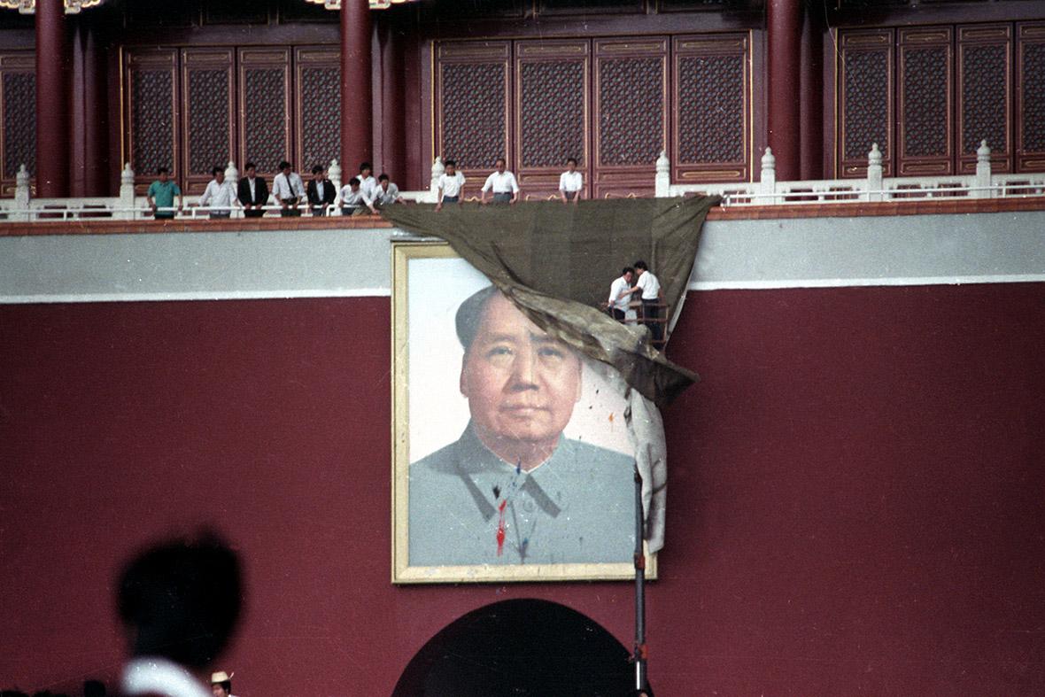 portrait of Mao defaced Tiananmen Square Beijing