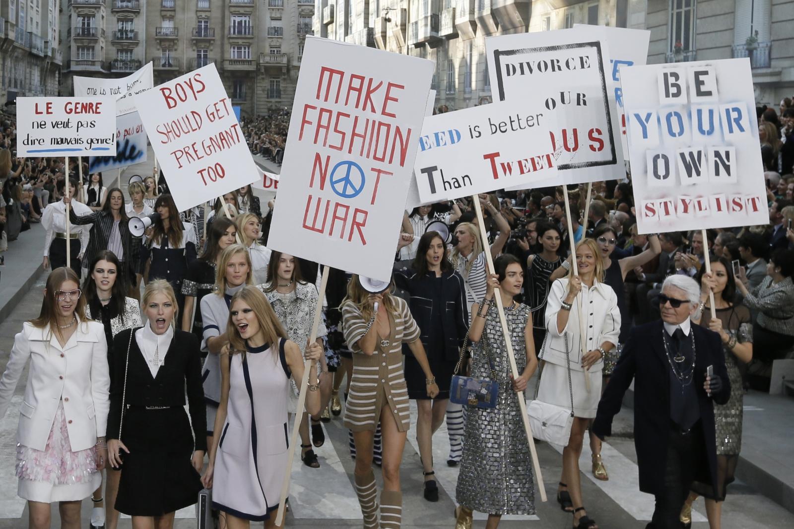 German designer Karl Lagerfeld with models staging a 'demonstration' during Paris Fashion Week