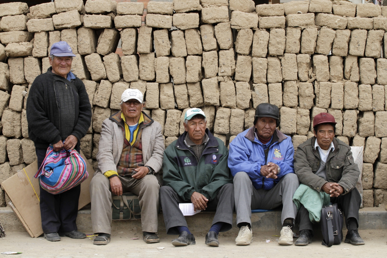 Pensioners take a break during a march towards La Paz in Patacamaya, south of La Paz, September 18, 2014. Bolivia's pensioners started a protest march to demand that President Evo Morales' government increase their pension.