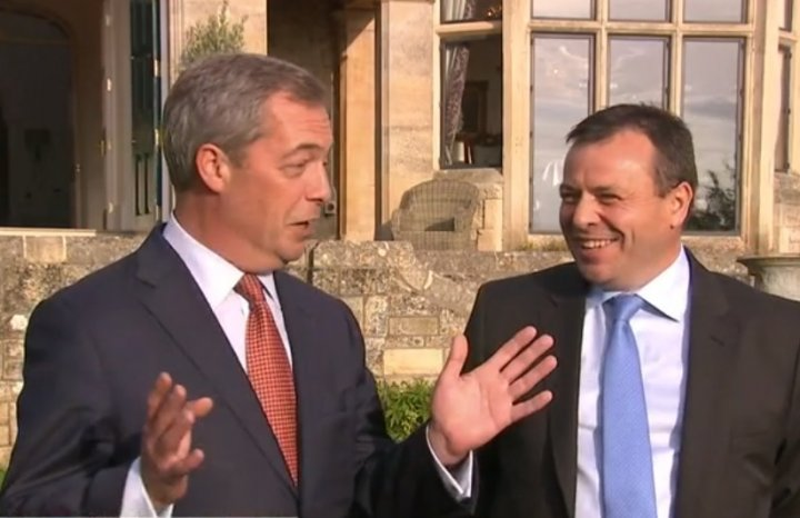 Arron Banks (left) with Ukip leader Nigel Farage as the millionaire announced he has defected from the Conservative party