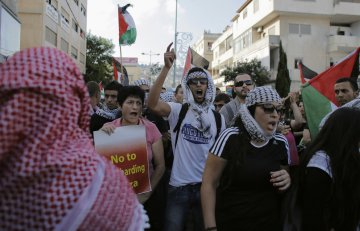 Israeli Arabs take part in a protest in the northern city of Nazareth, against Israel's offensive in the Gaza Strip July 21, 2014.