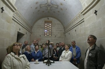 Tourists from Poland pray inside the Church of the Transfiguration on Mount Tabor near the northern Israeli city of Nazareth May 5, 2009