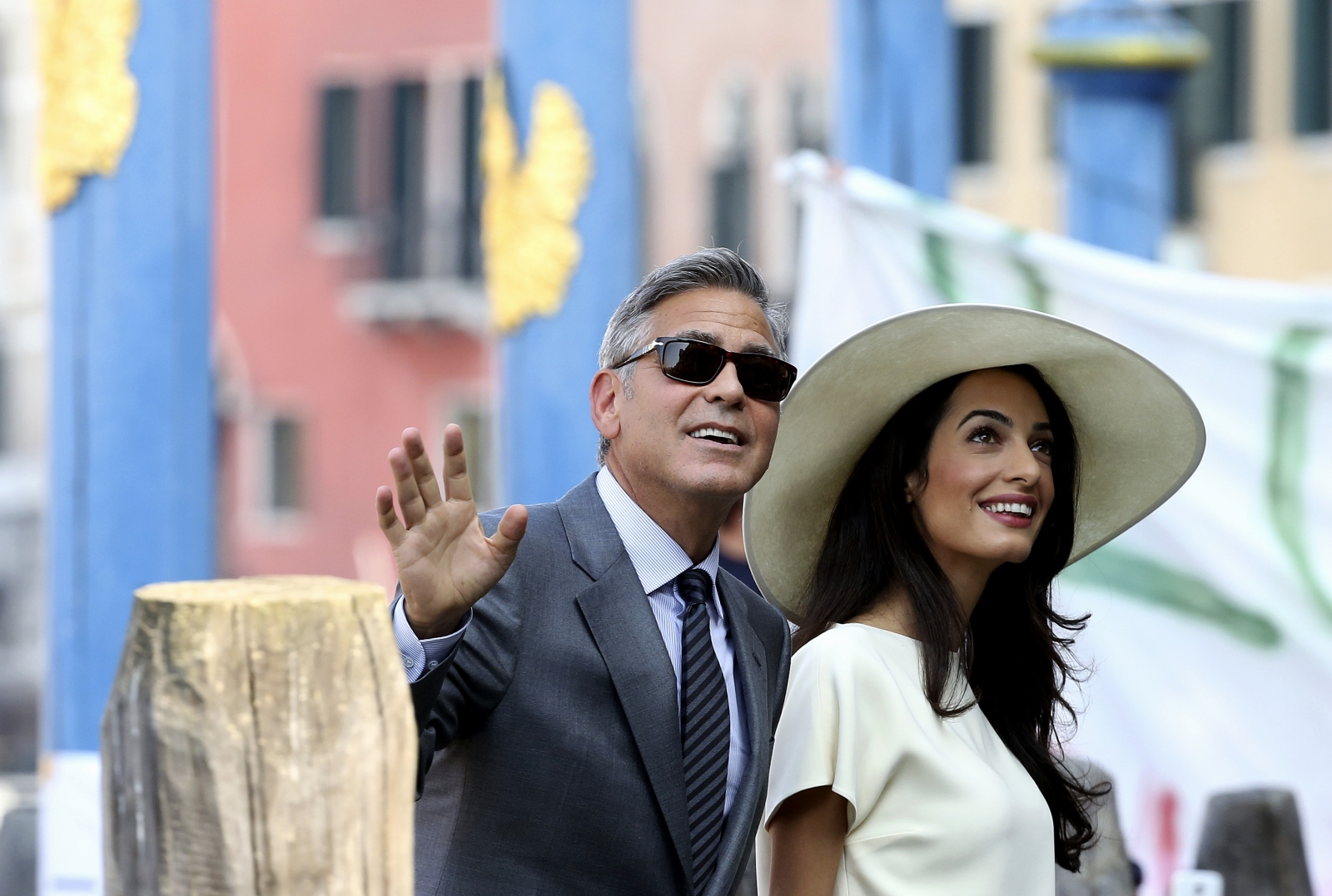 George Clooney and his wife Amal Alamuddin arrive at Venice city hall for a civil ceremony to formalise their wedding in Venice on 29 September, 2014