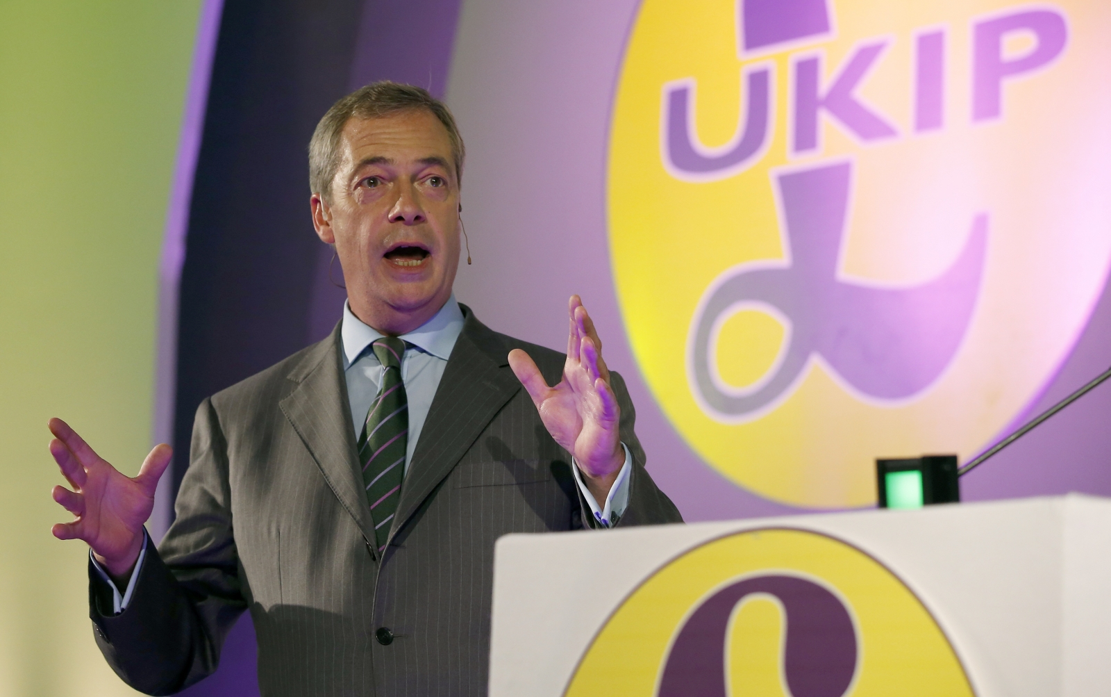 The leader of the United Kingdom Independence Party (UKIP) Nigel Farage delivers his speech at the party's annual conference at Doncaster Racecourse in Doncaster, northern England September 26, 2014