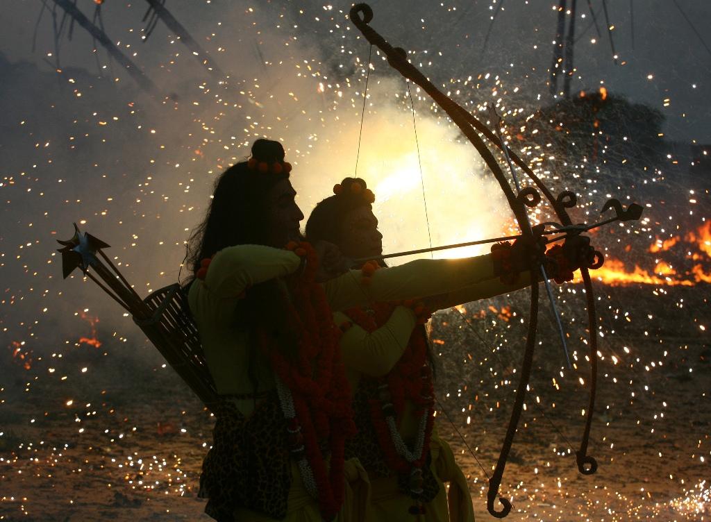 Artists dressed as Hindu Gods Rama and Laxman while performing the Ramlila