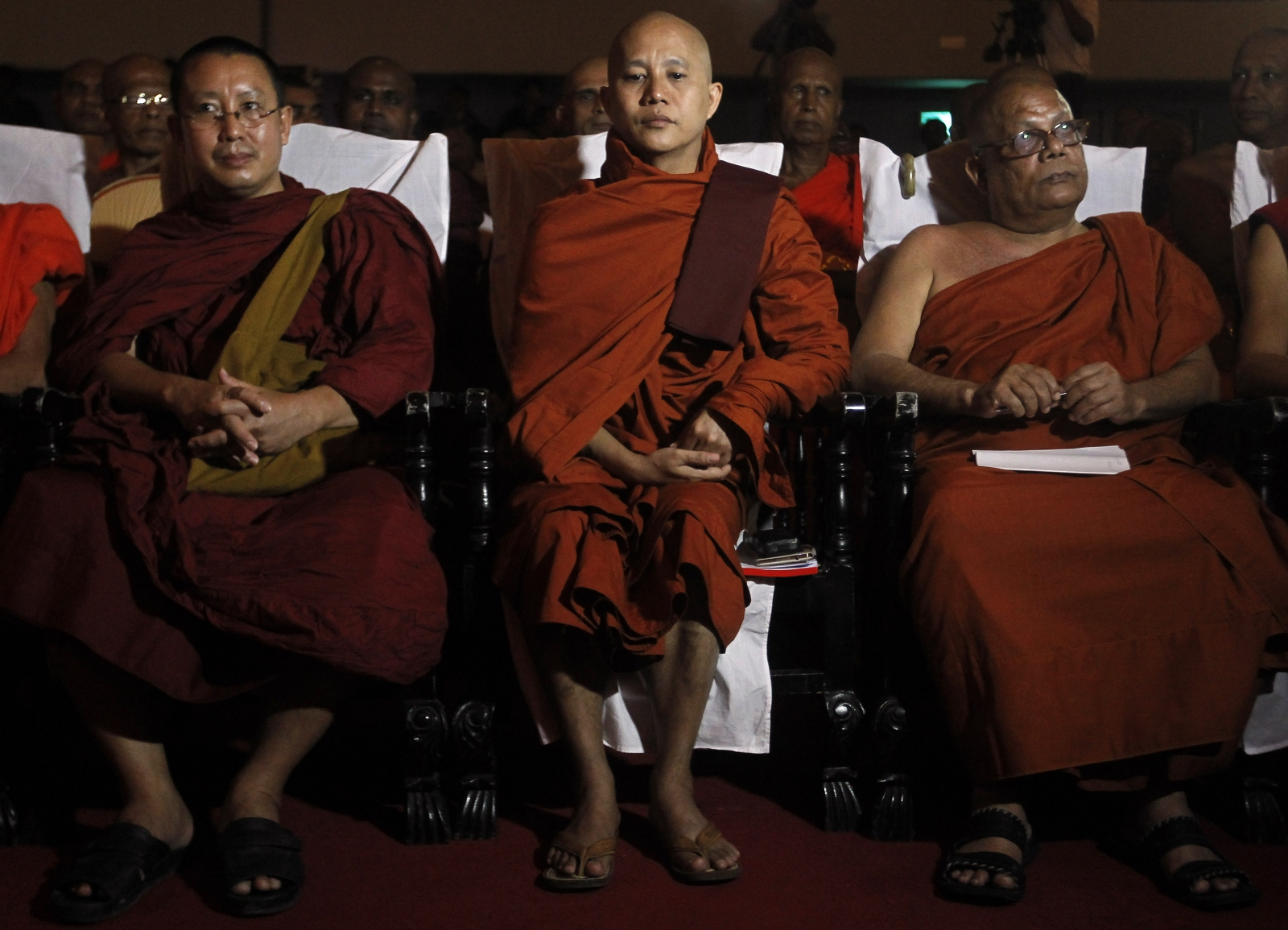 Buddhist monk Ashin Wirathu (C), leader of the 969 movement, looks on as he attends a convention held by the Bodu Bala Sena (Buddhist Power Force, BBS) in Colombo