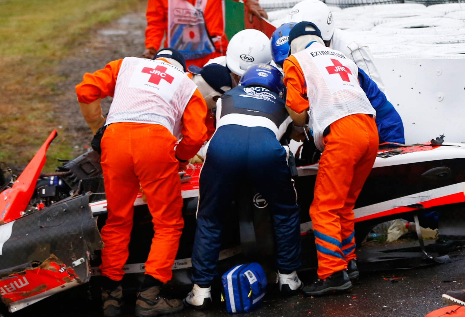 Jules Bianchi of France and Marussia receives urgent medical treatment after crashing during the Japanese Formula One Grand Prix at Suzuka (Getty)