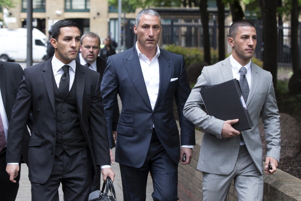 Millionaire property tycoon Andreas Panayiotou (C) with his sons George Panayiotou (R) and Costas Panayiotou.