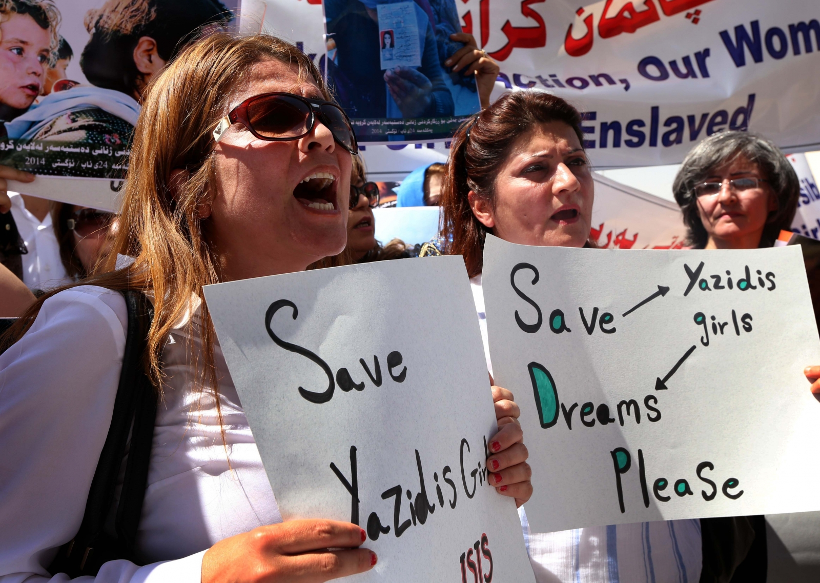 Iraqi Kurdish protesters denounce the Islamic State (IS) threat to Yazidi women and girls during a demonstration