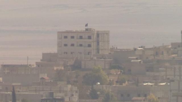 Syria: Isis Flag Flies over Kurdish Kobani