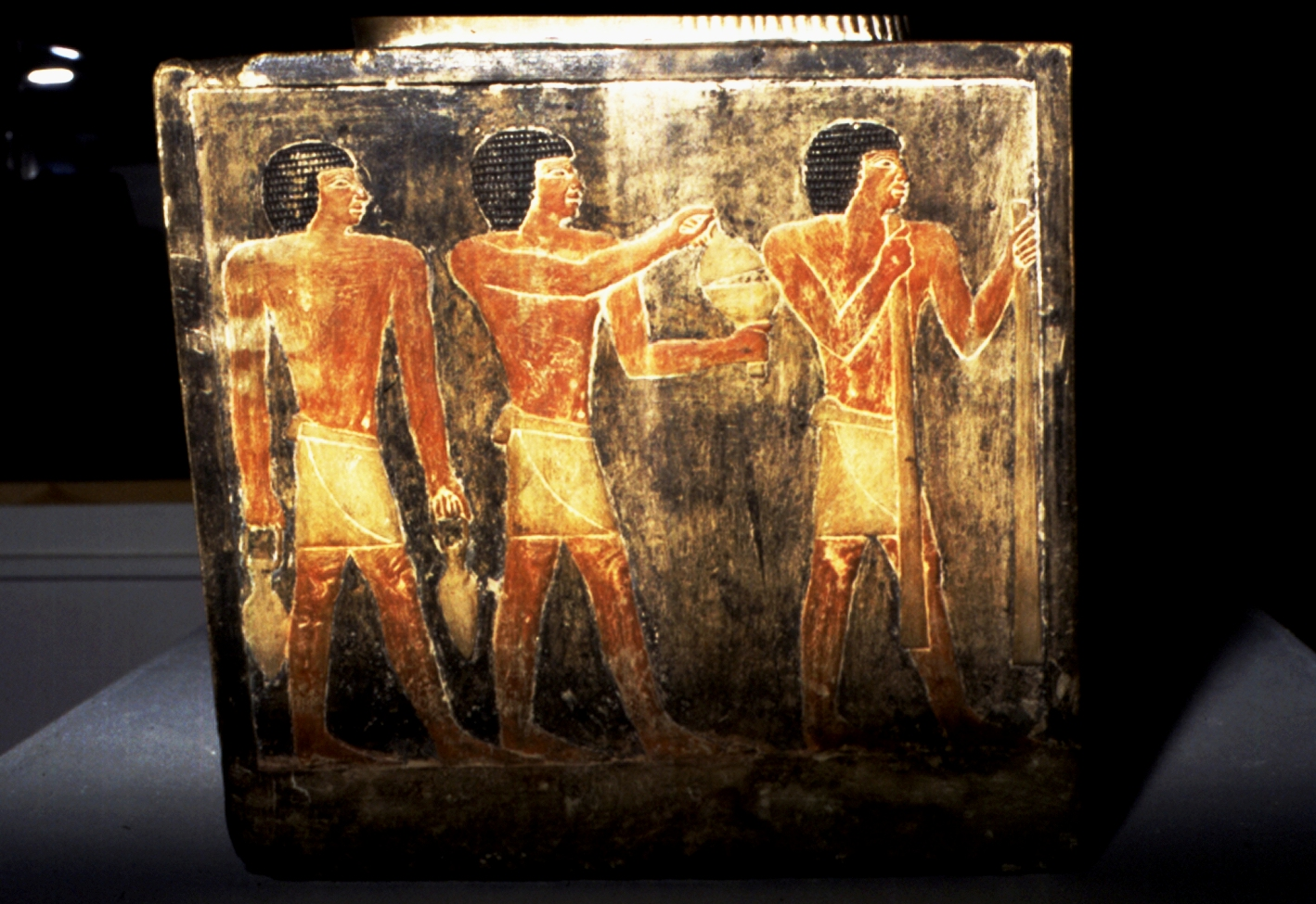The Sekhemka statue's base, which depicts ancient Egyptians carrying wine, bread and cake for the scribe's afterlife