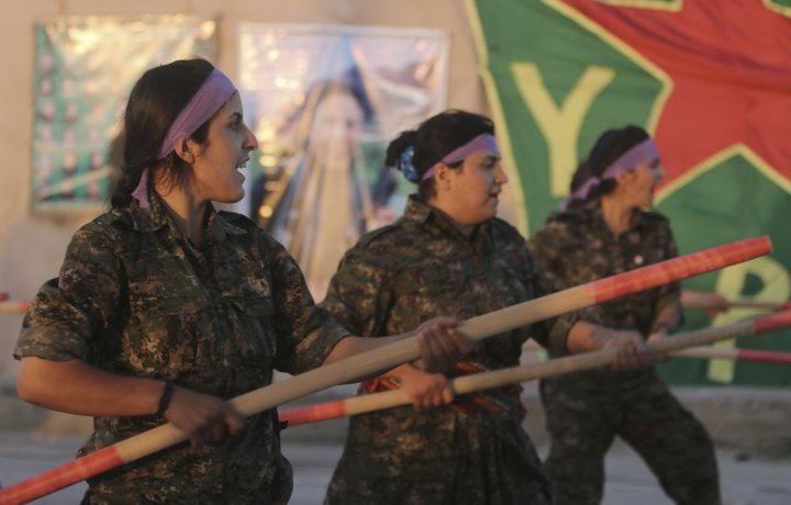 Kurdish female fighters of the Women's Protection Unit (YPJ) participate in training at a military camp in Ras al-Ain city in Hasakah province