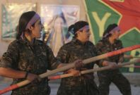 Kurdish female fighters of the Women\'s Protection Unit (YPJ) participate in training at a military camp in Ras al-Ain city in Hasakah province