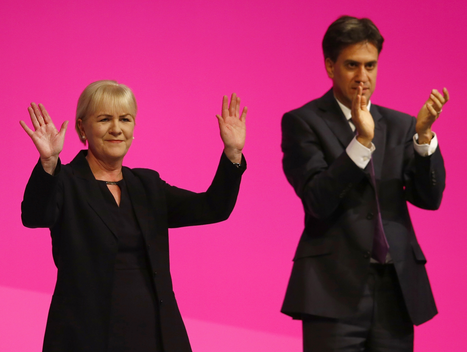 Britain's opposition Labour Party leader Ed Miliband (R) applauds Scottish Labour Party leader Johann Lamont during Labour's annual conference in Manchester, northern England September 22, 2014