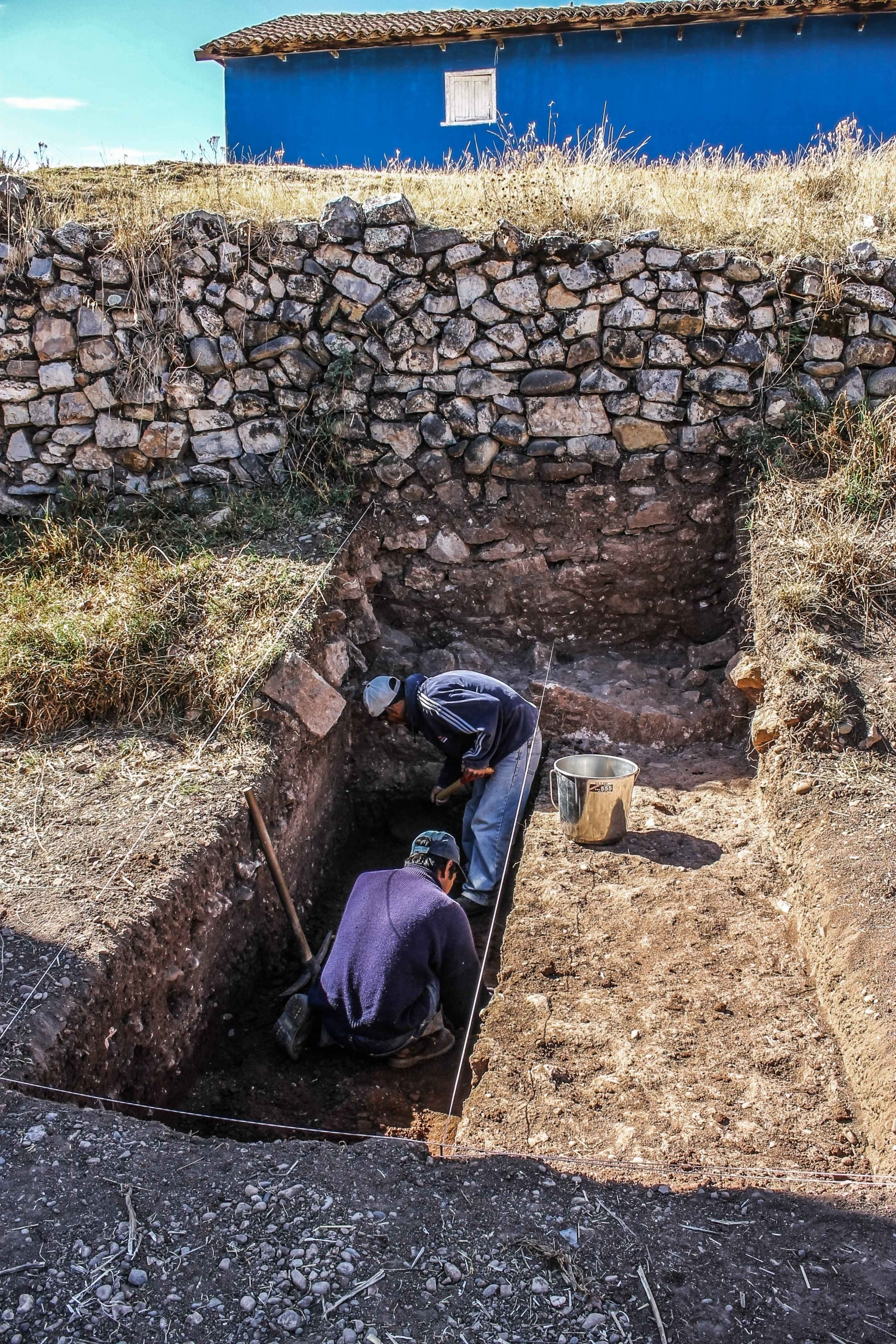 Peru state archaeologists digging near the remains of an ushnu stone ceremonial platform found in the city of Jauja