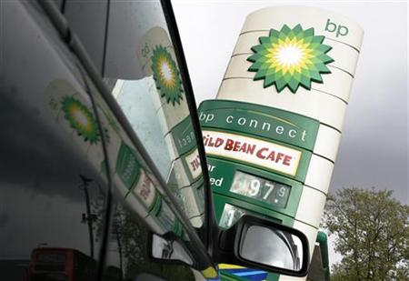BP petrol station is reflected in car windows in London